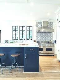 blue kitchen with marble a dark island and some chairs around it countertop blue marble dark river s countertop cabinets