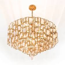 bel air chandelier a glamorous sy aesthetic presides over the design structure here shiny gold and hand wrapped rock crystal combine to create an