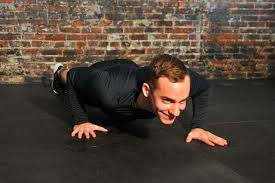 man doing a sgered push up