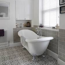 bathroom with roll top bath and patterned floor