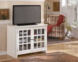 white tv stand with glass doors