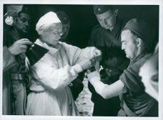 Generalmajor Richard kerman, prins Bertil och landshvding Ingvar Lindell  fljer den imponerande stridsskjutningen p stranden i Morup. / Fltmanver  Field maneuver 1973 SCAN-TT-00549377 - IMS Vintage Photos