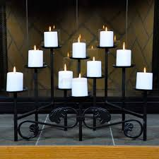 lovely black metal fireplace candelabra with ten white candle for
