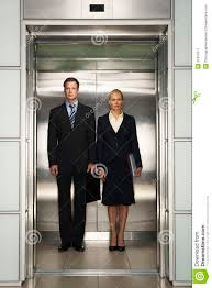 people standing in elevator. royalty-free stock photo. download business colleagues standing together in elevator people