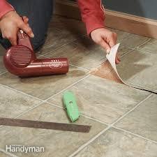 impressive on repair vinyl floor repair vinyl flooring patch damaged flooring the family handyman