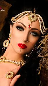 the soft hands and intense look pliments eachother well overly retouched though indian makeup