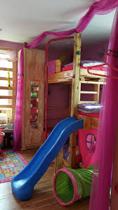 Kids custom made tripple bunk bed with slide, monkey bars, pole and rock  climbing