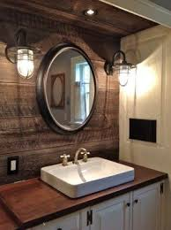 industrial lighting bathroom. round mirrors industrial lighting reclaimed barnwood counter mounted sink peruvian bathroom o