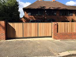 Small Picture Hardwood automated driveway gate red brick wall front garden