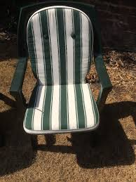 8 x high quality plastic garden chairs and 4 x seat covers