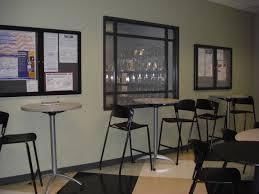 office break room design. cafe tables against wall to save room office break design
