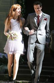 karen gillan stands out as bridesmaid in short dress and ankle Boots To Wedding her big entrance karen gillan wore a short dress with pleated detailing with slouchy black boots to a wedding