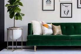 emerald green velvet tufted sofa on