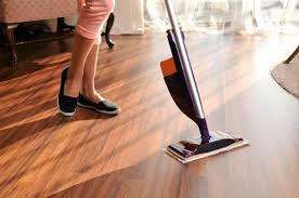 Womanu0027s Legs And Swiffer WetJet Style Electronic Mop On Wooden Floor