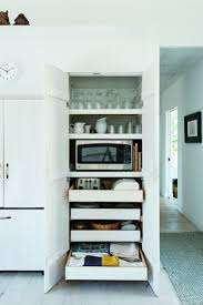 an awesome cabinet that holds a microwave toaster and breadbox