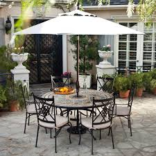 black wrought iron patio furniture with white paito umbrella and small round table shaped