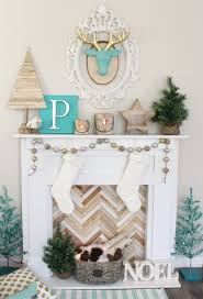 faux fireplace and mantel decor with reclaimed wood potted fir and pinecones