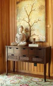 Bring serenity into a room by combining Buddha statues with a floral motif