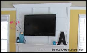 Framed Tv Above Fireplace Remodelaholic 95 Ways To Hide Or Decorate Around The Tv