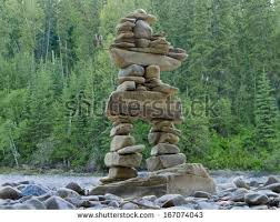 balanced form large rocks stacked balanced form inuksuk stock photo royalty free