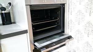 clean inside glass oven door clean inside oven door cleaning glass close up of female hand