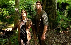 no competition hunger games rakes in m ny daily news katniss jennifer lawrence and gale liam hemsworth in the hunger games