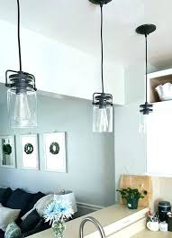 pendant light over kitchen sink distance from wall 3 lights height above