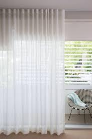 stunning sheer white linen curtains overlaying sleek helioscreen bloc out roller blinds plantation