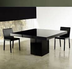 beech square dining table features central base and table top in lacquer or wood