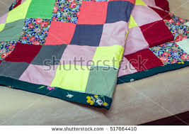 Patchwork Quilt Stock Images, Royalty-Free Images & Vectors ... & Patchwork quilt. Part of patchwork quilt as background. Flower print. Color  blanket in Adamdwight.com