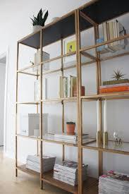 storage freestanding tall bookcase design metal construction bronze finish open shelves compartment clear glass shelf panel