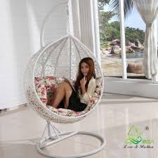 Swinging Chairs For Bedrooms Appealing Hanging Egg Chair With Brown Stand And Black Rattan Egg