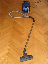 miele canister vacuum on hardwood floors jpg