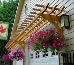 how to level a garage doorHanging baskets dress up a garage arbor  Curb Appeal  Pinterest