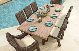wicker outdoor dining furniture with faux wood table