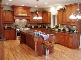 delightful fake wooden kitchen floor plans with mahogany kitchen cabinets as well as hanging island lamps in large rustic kitchen ideas