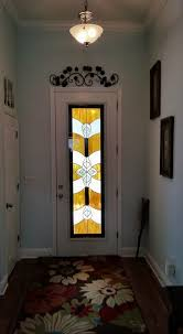 custom door glass insert with stained glass design in hurricane impact