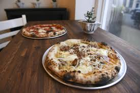 the bolognese pizza front and margherita pizza are seen at nonavo pizza in downtown