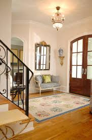 entrance foyer furniture. this entryway has a countrychic style with blocked floral rug and plaid entrance foyer furniture