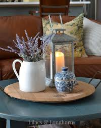 you could add a few diffe elements such as a small clock a vase or pitcher with or without flowers and candles it good to vary the heights of what