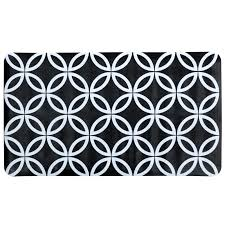 black white geometric circles bath mat on white background