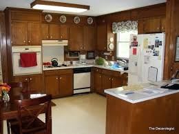 1970s kitchen remodel the kitchen light fixtures and paint your dated wood paneling cabinets for an 1970s kitchen
