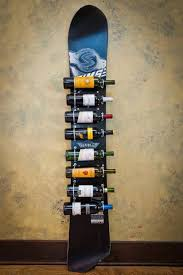 wine racks made from skis and snowboards these are cool don t drink wine surely they can be made to hold jägermeister