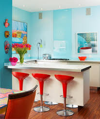 bright coloured furniture. blue wall paint and red chairs bright coloured furniture s