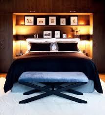 award winning alpine chalet trendy bedroom photo with medium tone hardwood floors charming bedroom furniture