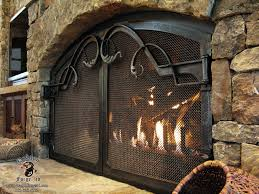 forged acanthus pulls on arched fireplace doors zoom in
