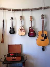 hang guitar on wall