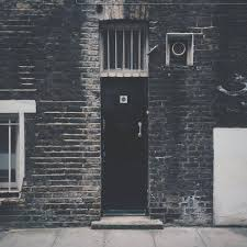 black doors dirty brick walls door entrance