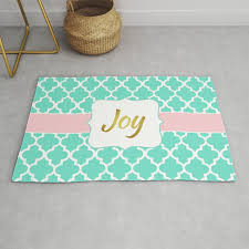 joy mint moroccan quatrefoil pattern with pink and gold accents rug