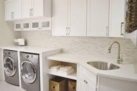white shaker cabinets with quartz countertops. photo of best cheer stone - anaheim, ca, united states. laundry room display white shaker cabinets with quartz countertops d